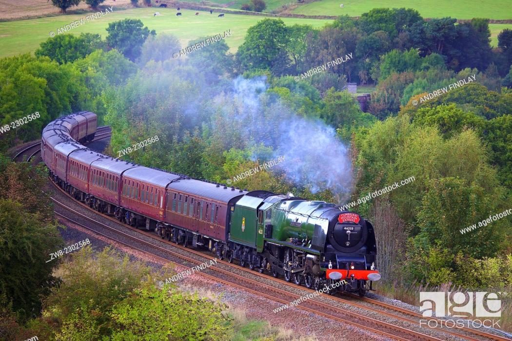 Stock Photo: Steam locomotive LMS Princess Coronation Class 46233 'Duchess of Sutherland' near Low Baron Wood Farm Armathwaite Eden Valley, Cumbria, England, UK.