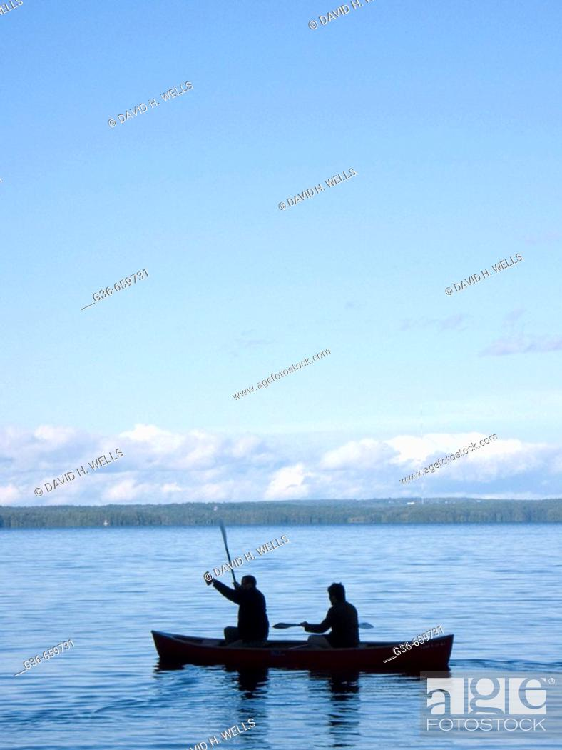 Stock Photo: Canoers at sunset in Sebago Lake, Maine.