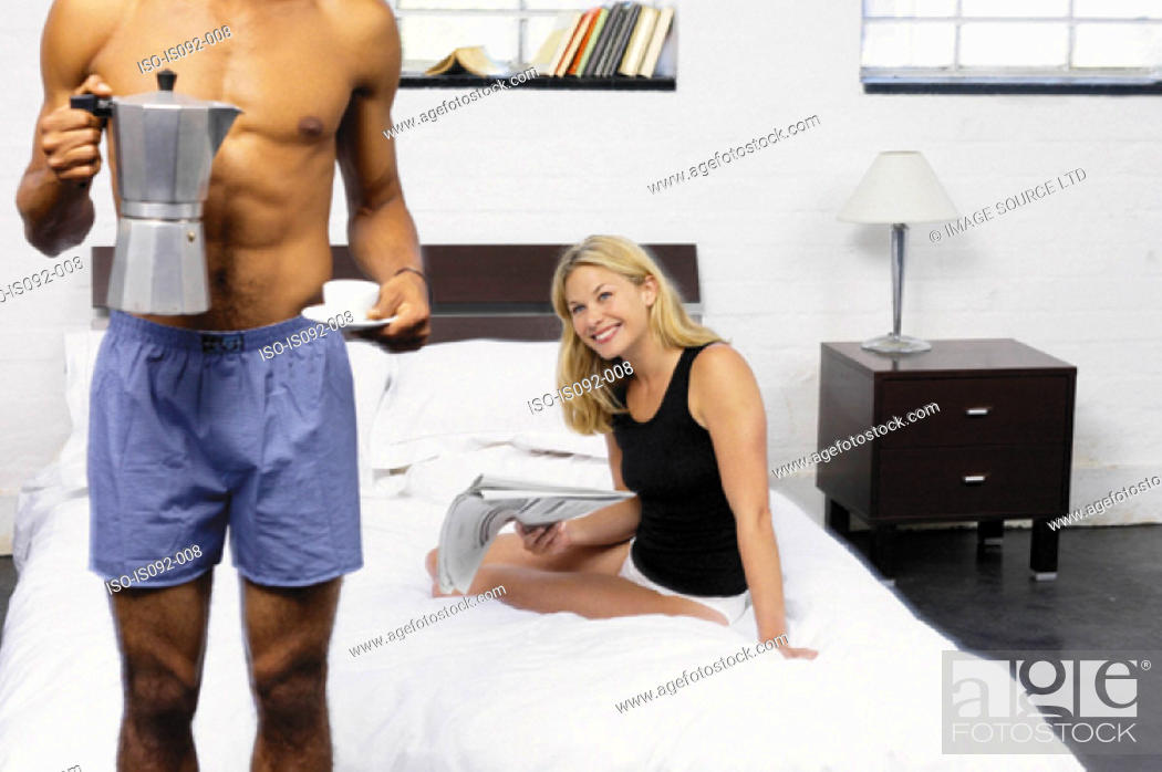 Stock Photo: Couple having coffee in bed.