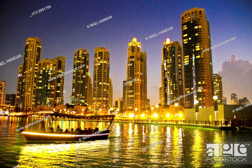 Stock Photo: Boat atThe Dubai Fountain, Dubai, United Arab Emirates.