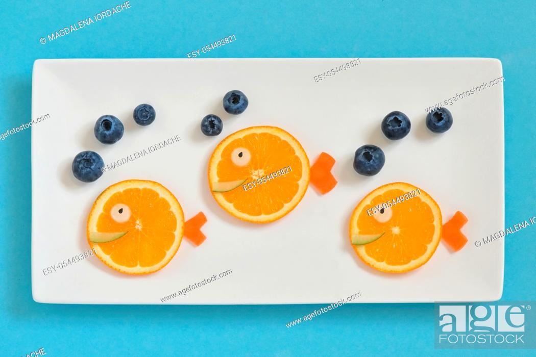 Stock Photo: Creative Children's Breakfast With Fruits.