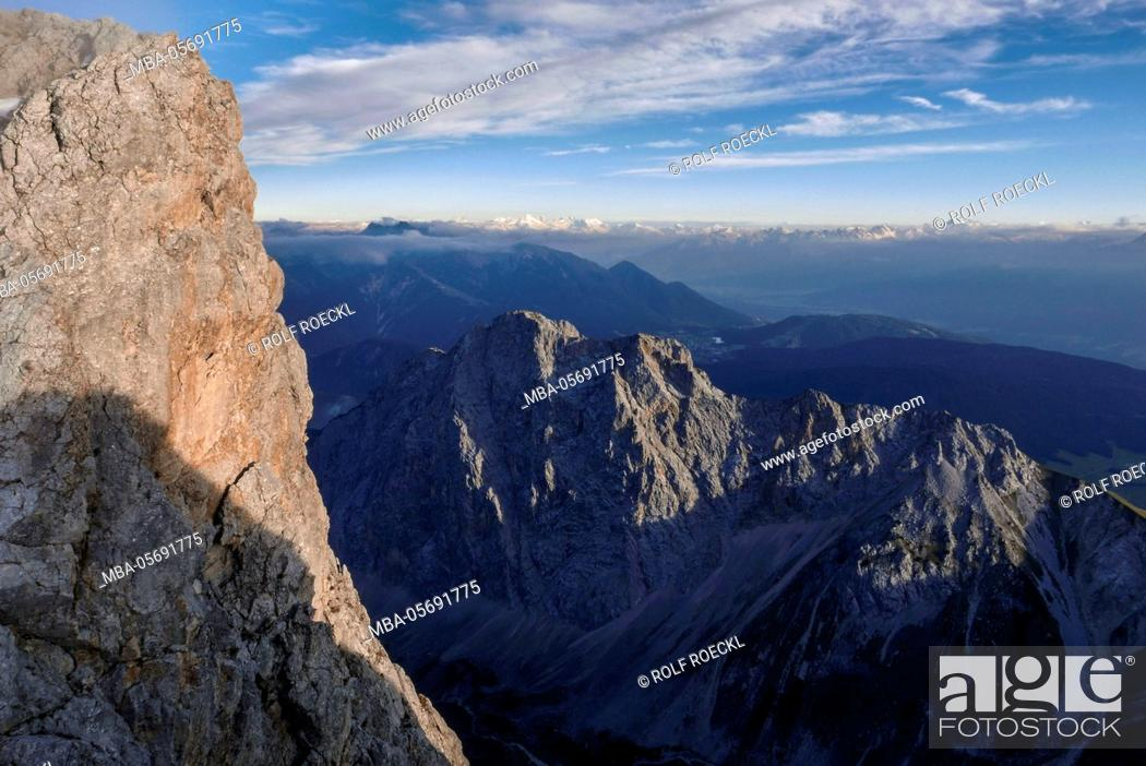 Stock Photo: rock Storm at the Schüsselkarspitze west ridge, Wetterstein Range, view at Gehrenspitze and Zillertaler alps and Kalkkögel and hawk,.