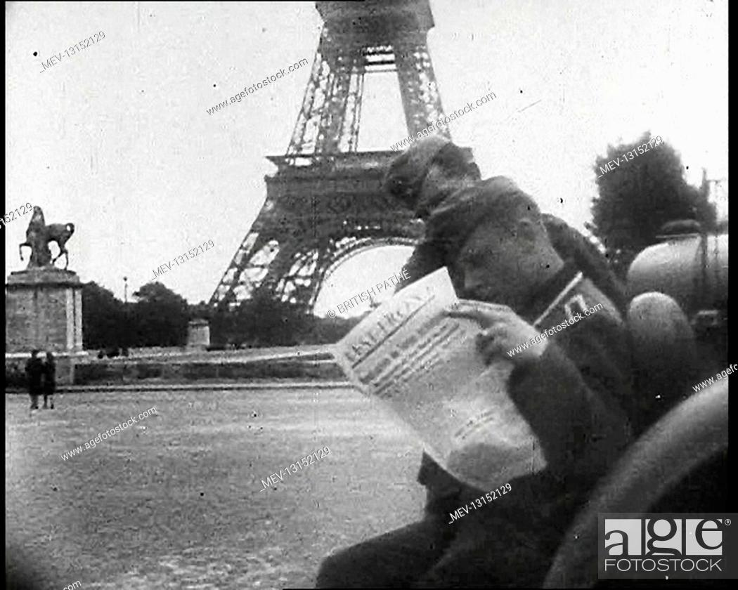 Stock Photo: Two German Soldiers Reading A Newspaper Near the Eiffel Tower, Paris - Paris, Vichy France.