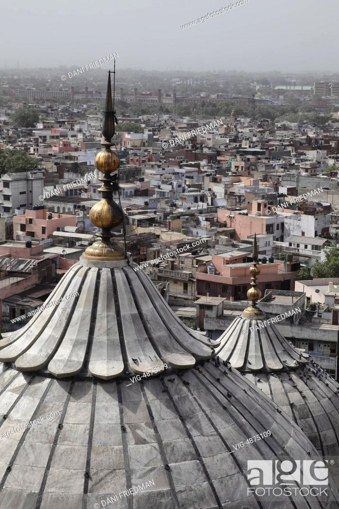 Stock Photo: The domed roofs of the Jamia Masjid (Jama Masjid) tower over the city of Old Delhi, Delhi, India. The Jamia Masjid is the principal mosque of Old Delhi and was.