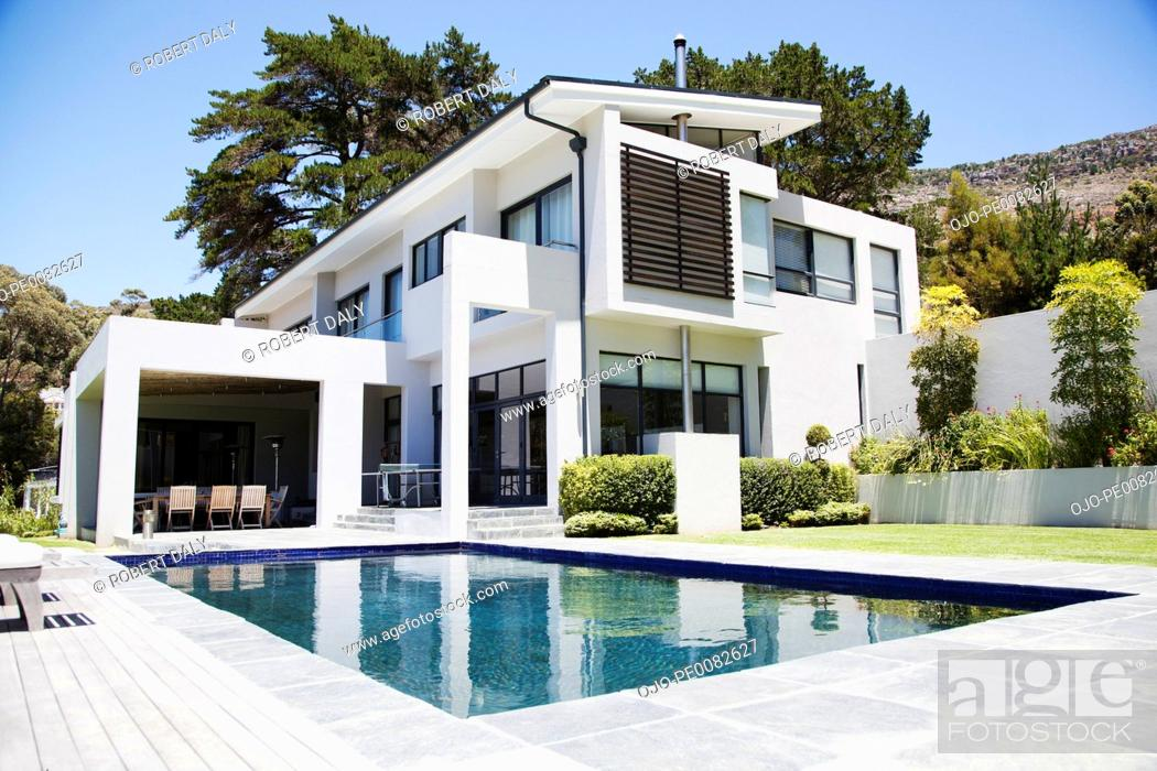 Stock Photo: Modern home with swimming pool.