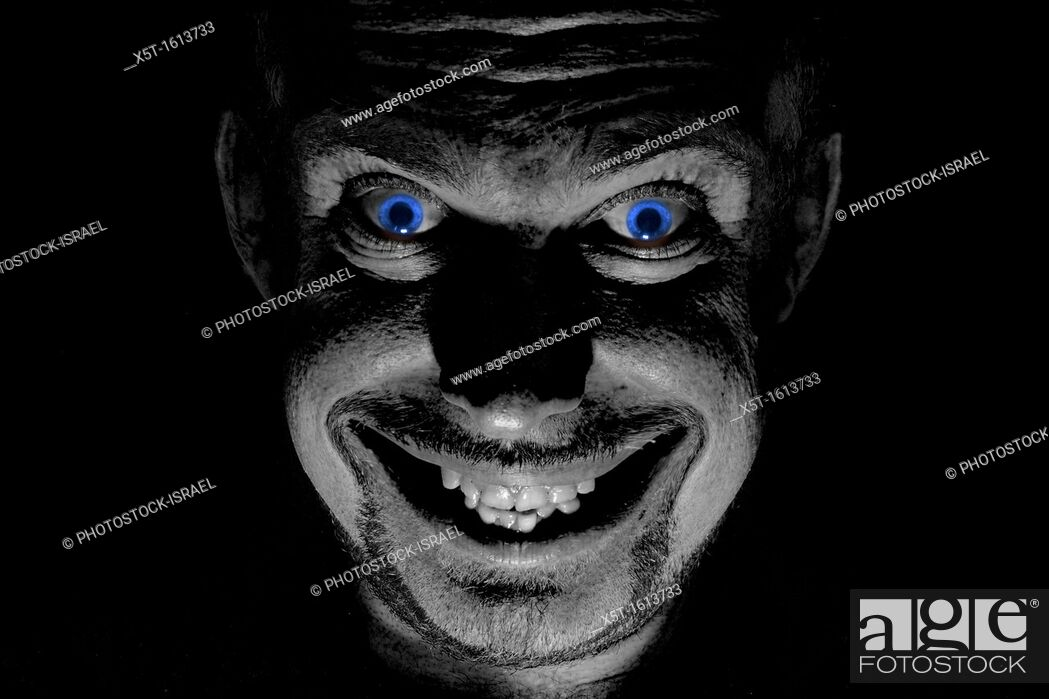 Stock Photo: Blue eyed demon with an evil smile.