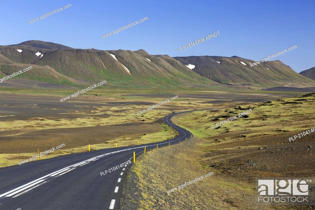Stock Photo: Empty Route 1 / Ring Road, winding national road in desolate barren landscape in summer at Austurland, East Iceland.