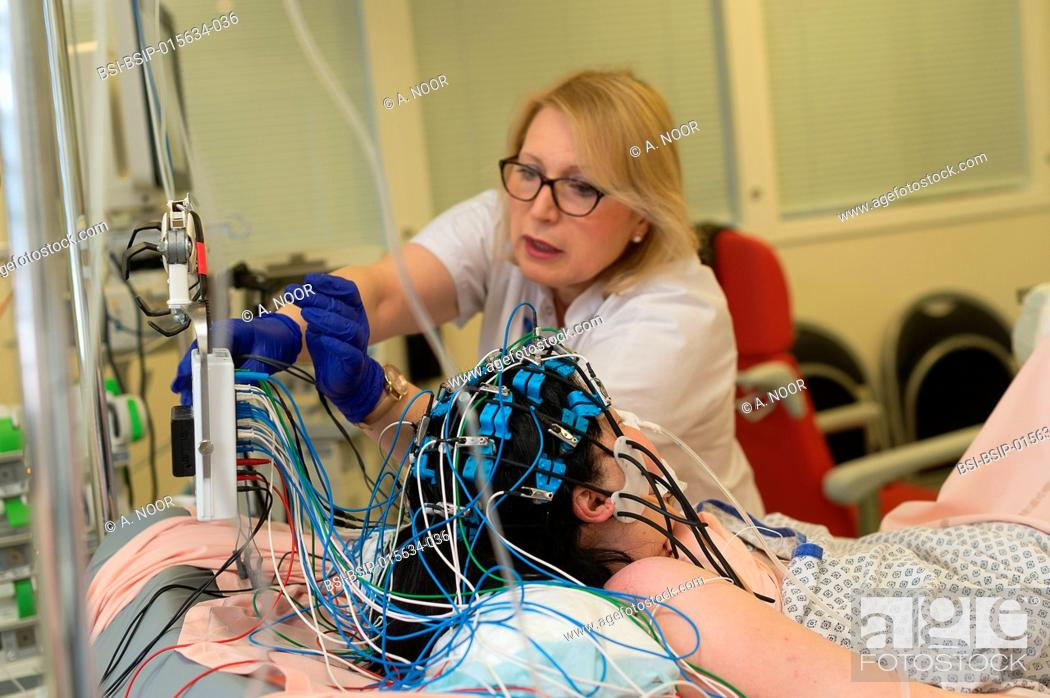 Stock Photo: Reportage in the epileptology unit in Nice Hospital, France. Carrying out an emergency EEG in the intensive care service on a patient who was hospitalized.