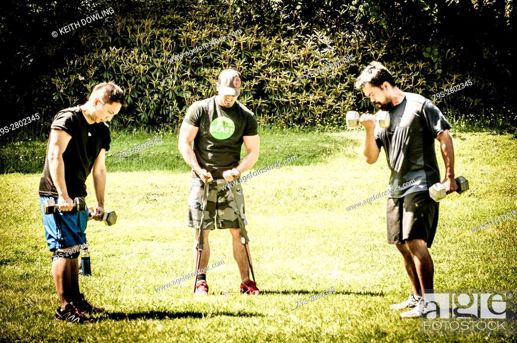Stock Photo: Working out in the Park, with free weights, Vancouver BC, Canada.