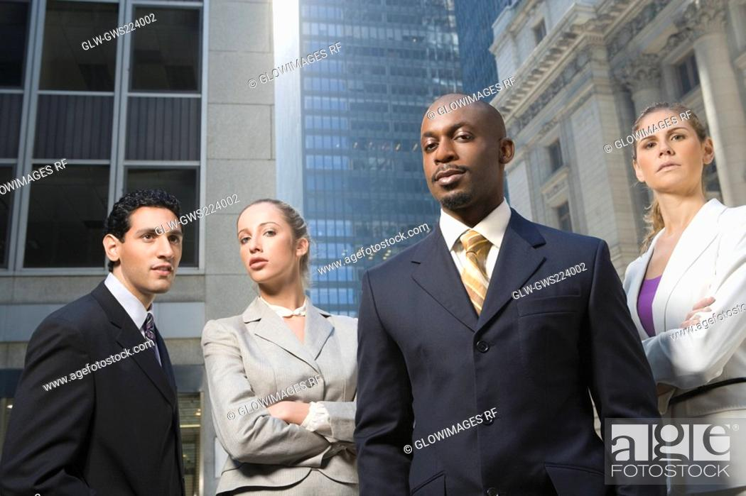 Stock Photo: Two businessmen standing with two businesswomen.