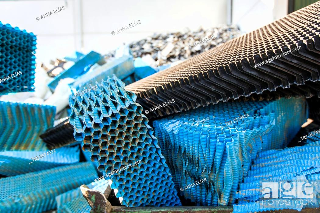 Stock Photo: warehouse full of plastic garbage and other items for recycling.