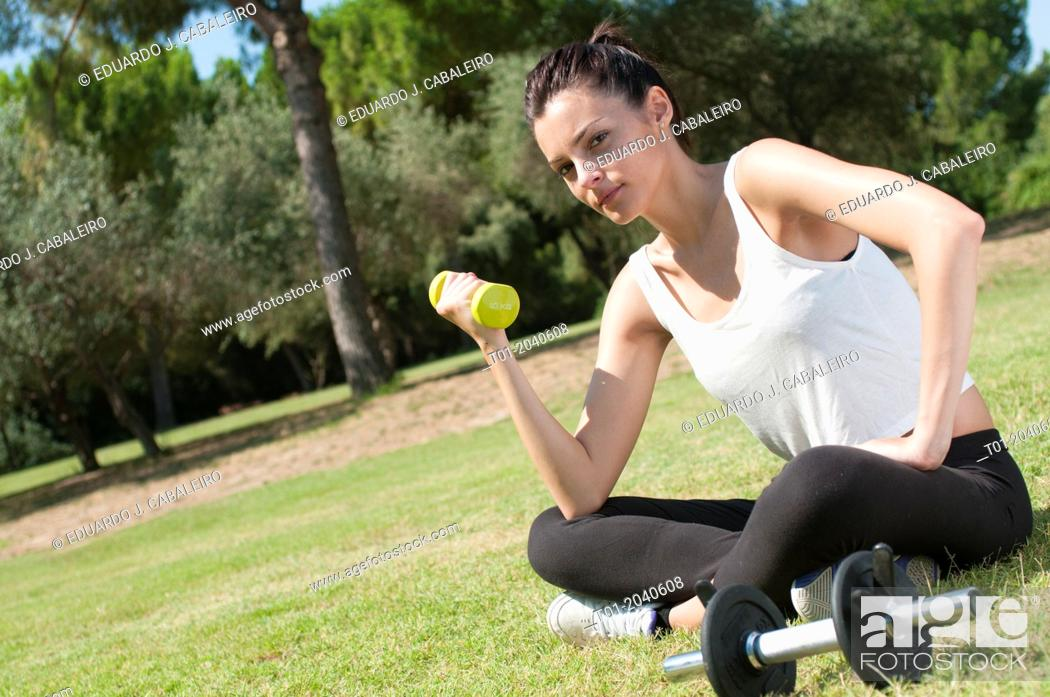 Stock Photo: girl doing sports in a park.
