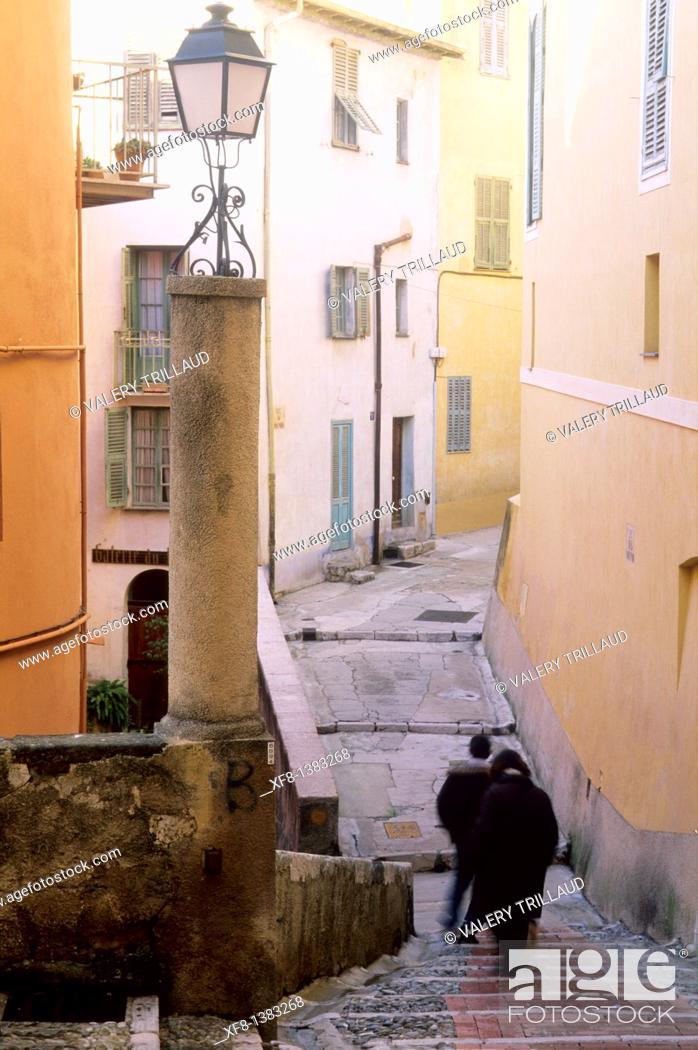 Stock Photo: Narrow street in the old city of Menton, Alpes-Maritimes, Provence-Alpes-Côte d'Azur, France.