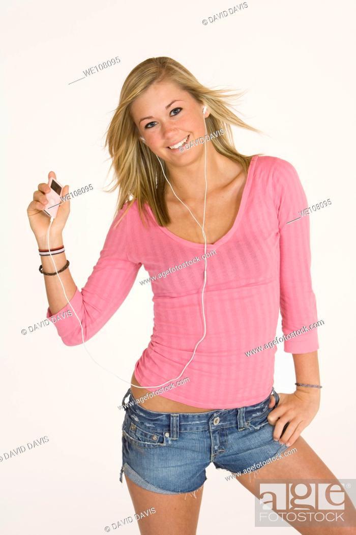Stock Photo: Teenage girl listening to music.
