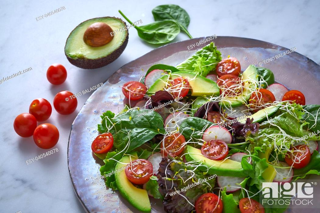 Stock Photo: Avocado salad with sprouts tomatoes spinach and radish healthy food.