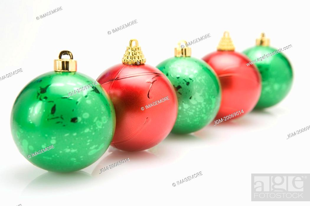 Stock Photo: Christmas baubles in a row.
