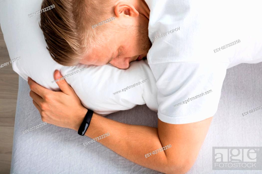 Stock Photo: Elevated View Of A Man Sleeping On Bed.