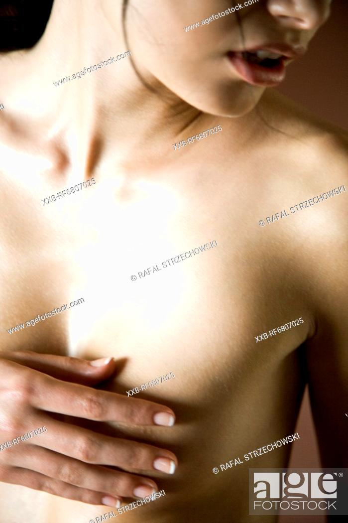 Stock Photo: Young woman covering breast.