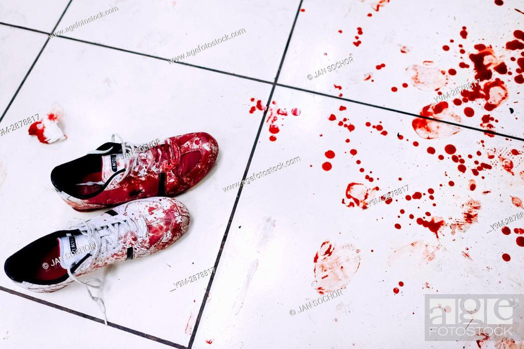 Stock Photo: Bloodied sneakers of a deadly injured gang member, lying next to a splash of blood, are seen on the floor of the emergency department of a public hospital in.