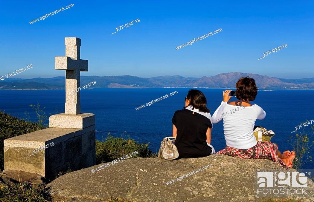 Stock Photo: Tourists and Cross  Cape Finisterre  Finisterre Coruña province Spain  Camino de Santiago.
