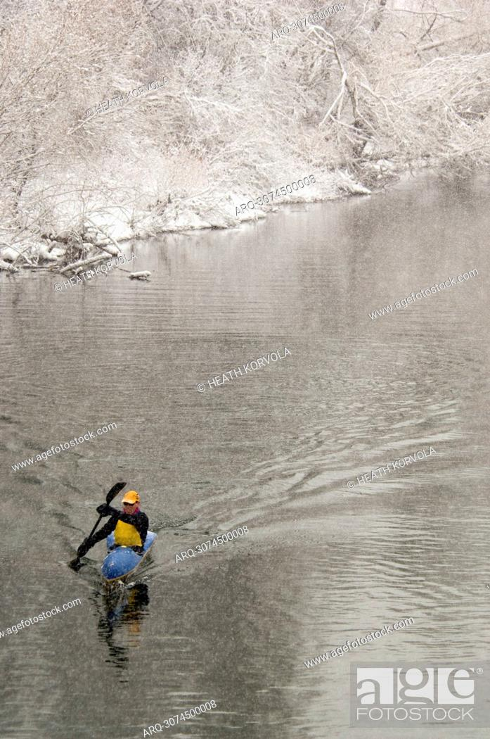 Stock Photo: A former US National Team paddler kayaks on a river in Whitefish, MT.