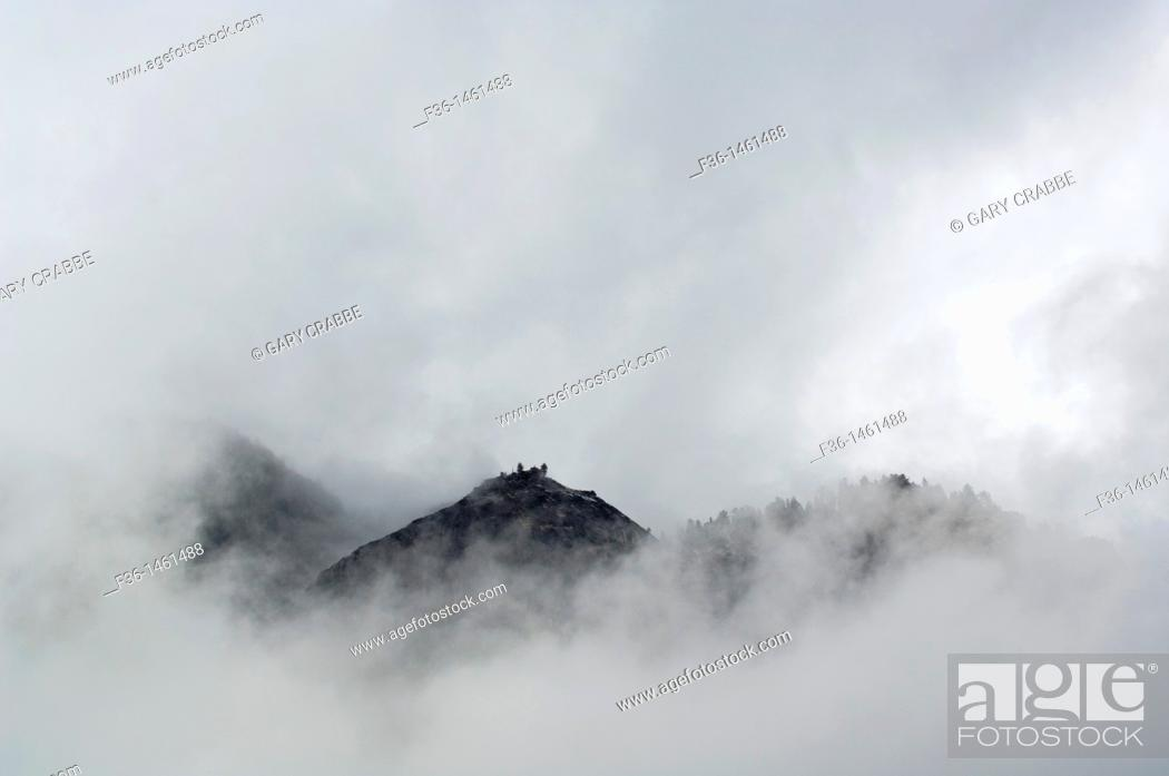 Stock Photo: Clouds shroud Washington Dome, Yosemite National Park, California.