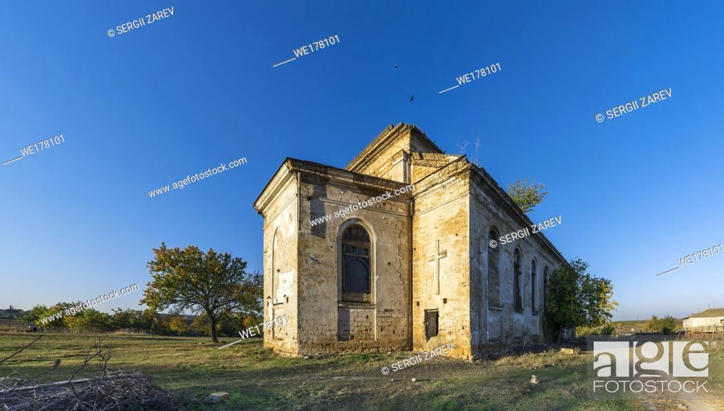 Stock Photo: Abandoned Catholic church of the Nativity of the Blessed Virgin Mary in the village of Kamenka, Odessa region, Ukraine.