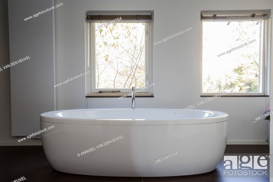Stock Photo: White freestanding bathtub in designed modern bathroom, modern design.