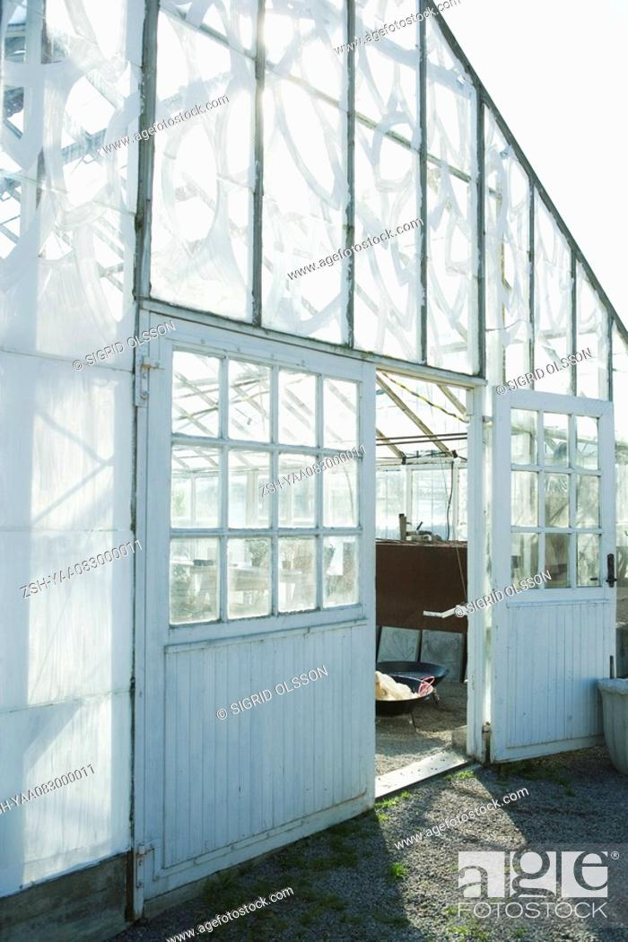 Stock Photo: Greenhouse, door propped open.