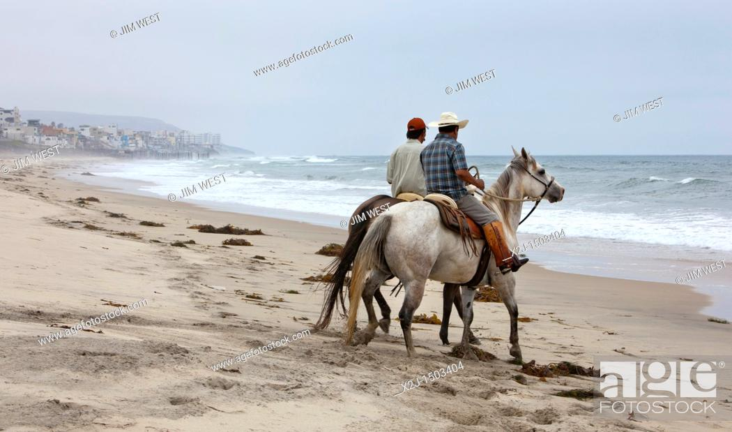 Stock Photo San Ysidro California Horseback Riders On The Beach By Pacific