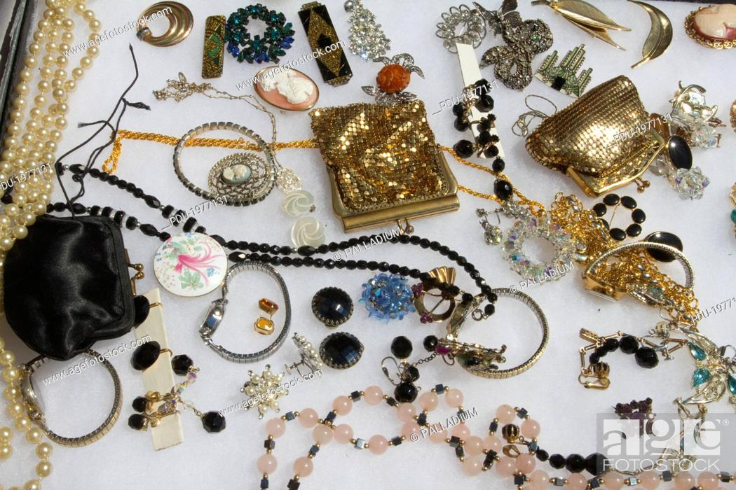 Stock Photo: Flea market display of jewellery.