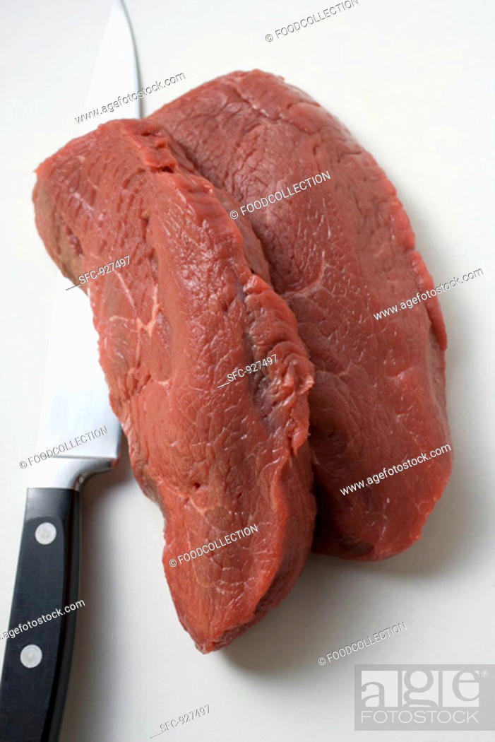 Stock Photo: Two slices of beef sirloin with knife.