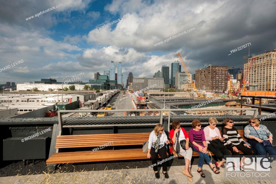 Stock Photo: Looking up 11th Avenue, visitors rest on the third and final phase of the popular High Line Park, from West 30th Street to West 34th Street, in New York.