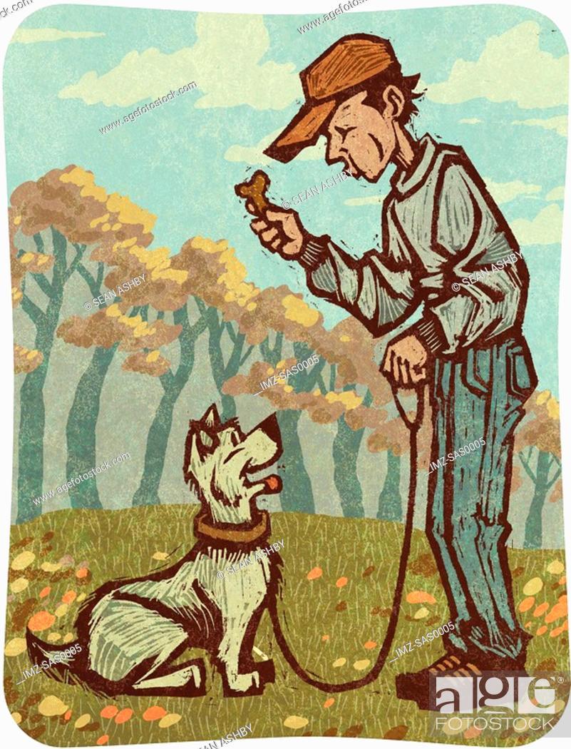 Stock Photo: A man training a dog.