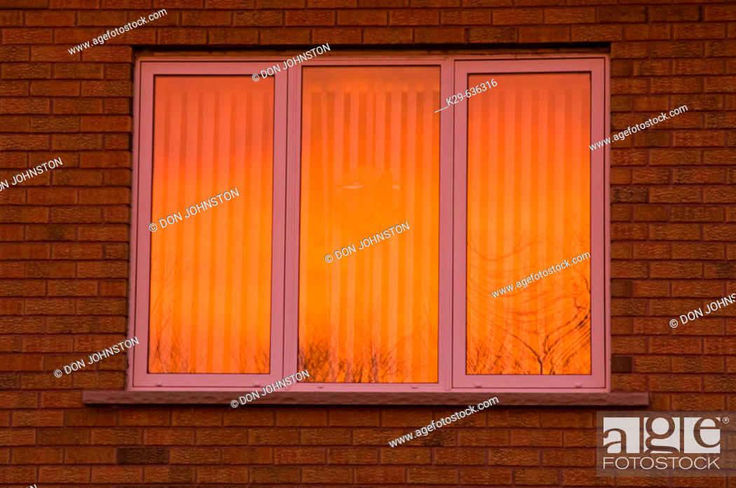 Stock Photo: Sunset skies reflected in windows.