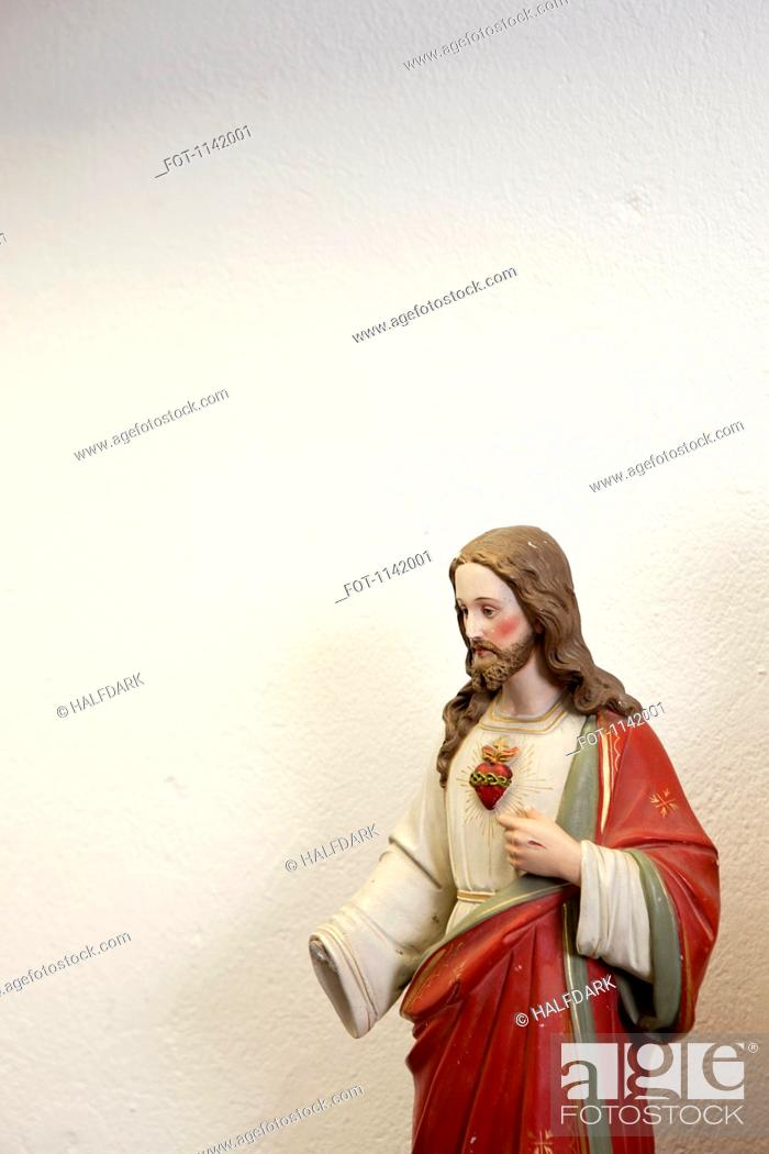 Stock Photo: Figurine of Jesus with a missing hand.