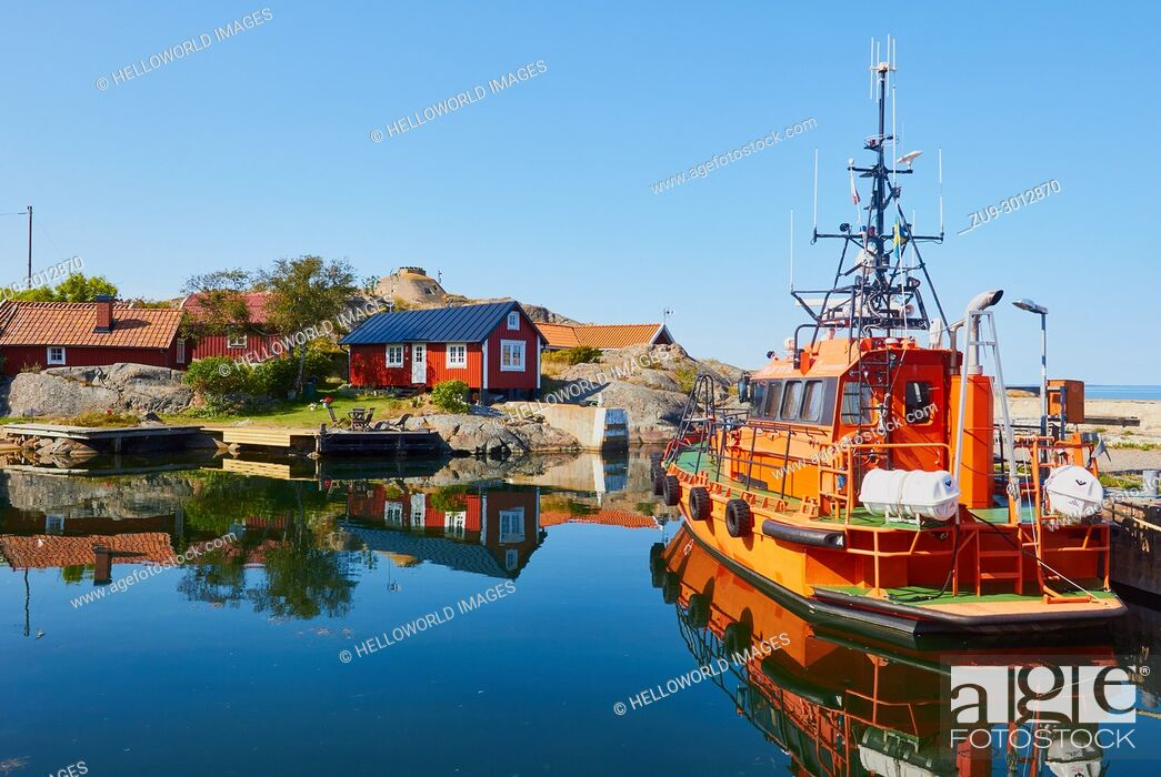Stock Photo: Orange pilot boat in Vasterhamn (west harbour) on the island of Oja (Landsort), the southernmost point in the Stockholm archipelago, Sweden, Scandinavia.