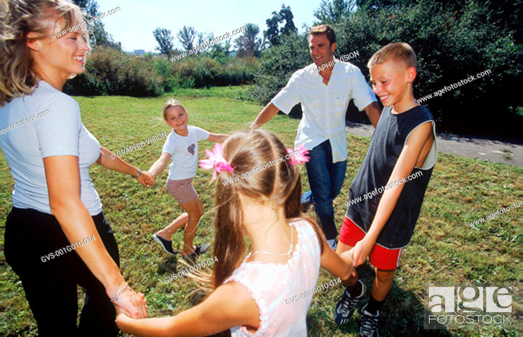 Stock Photo: Family playing ring around a rosy.
