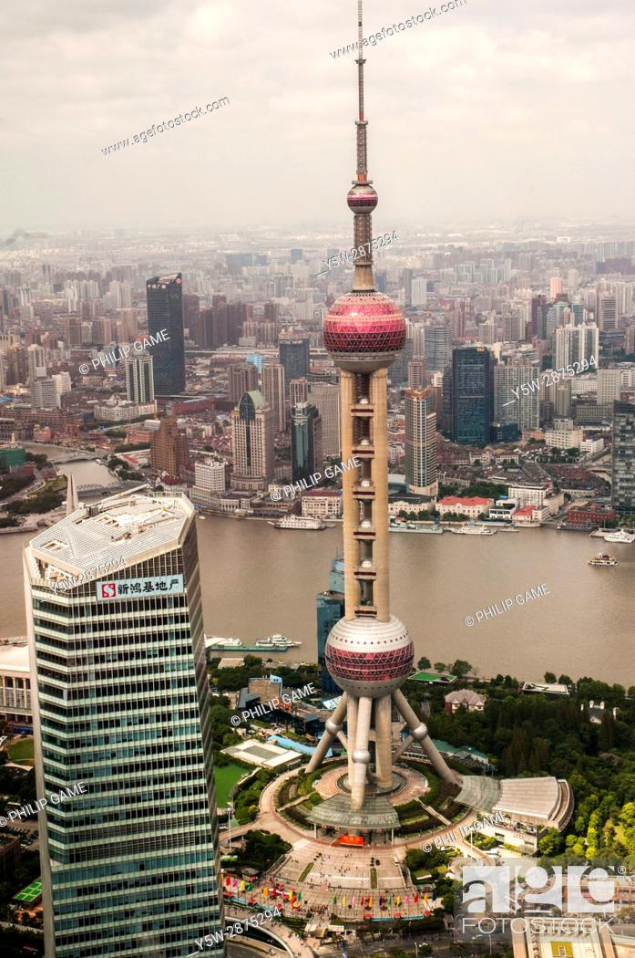 Stock Photo: Shanghai visible beyond the Huangpo, with the Oriental Pearl Radio and TV Tower, Pudong New Area, in foreground. China.