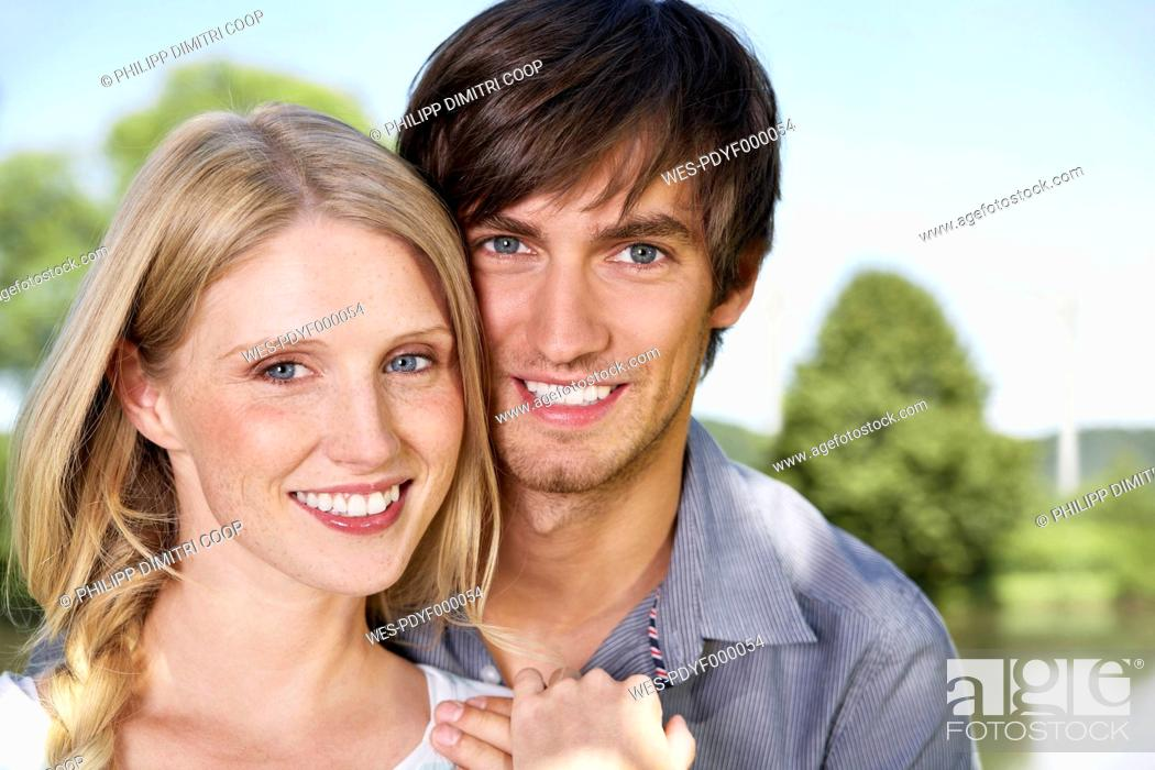 Stock Photo: Germany, Cologne, Young couple smiling, portrait.