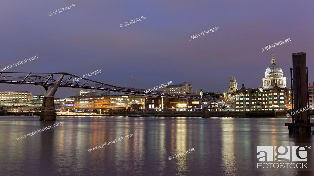 Imagen: Evening lights on Millennium Bridge and dome of St. Paul's Cathedral, London, Great Britain, UK.