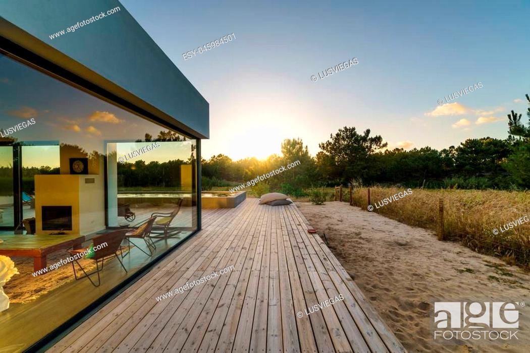 Modern House With Garden Swimming Pool And Wooden Deck Stock