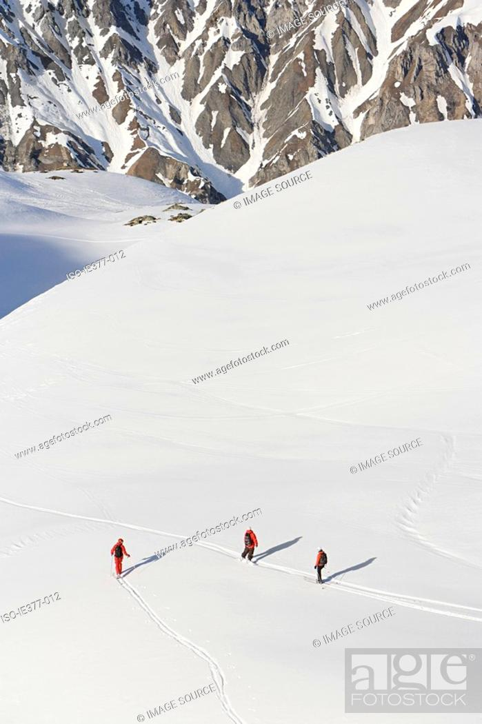 Stock Photo: An elevated view of people skiing.