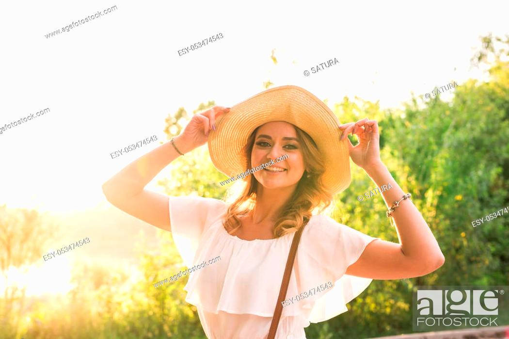 Stock Photo: Beach woman laughing having fun in summer vacation holidays. Girl wearing big straw hat.