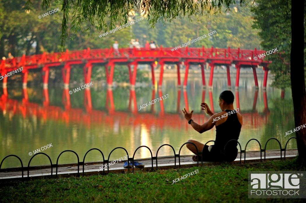 Stock Photo: early morning exercises beside Hoan Kiem Lake, Hanoi, Vietnam.