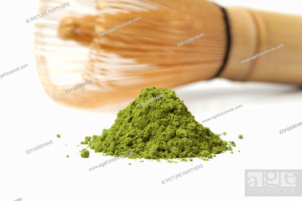 Photo de stock: Heap of powdered green matcha tea and chasen on white background.