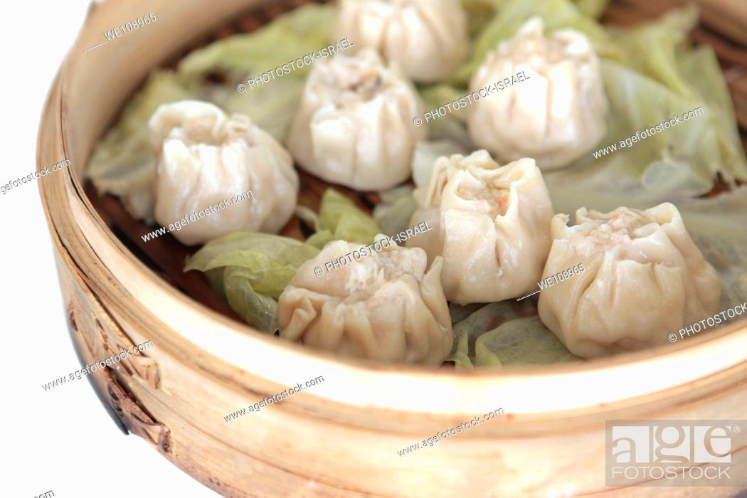Stock Photo: Chinese Dumplings in Bamboo Steamer.