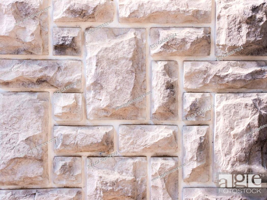Stock Photo: a wall from an artificial gray stone facade with rough fractured surfaces.