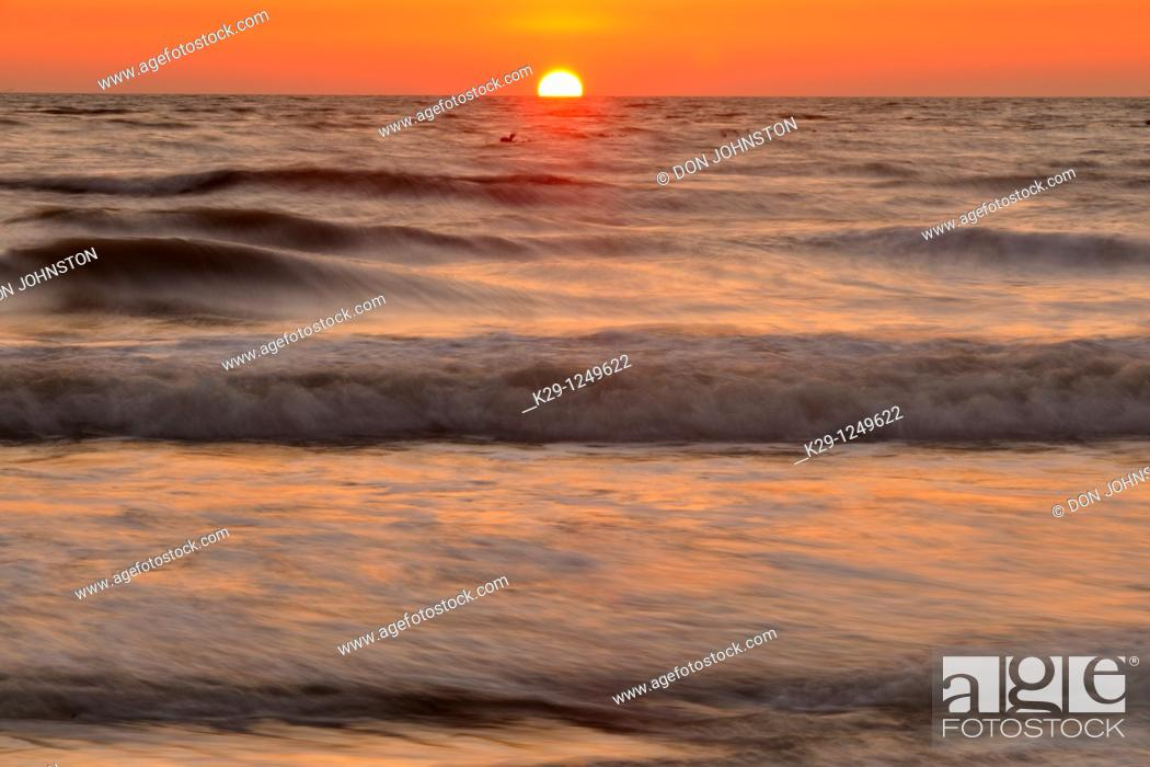 Stock Photo: Gulf beach and surf after sunset.