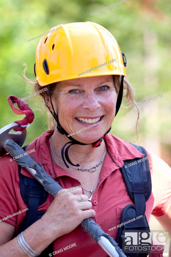 Stock Photo: A woman on a zip line tour in Whitefish, Montana.